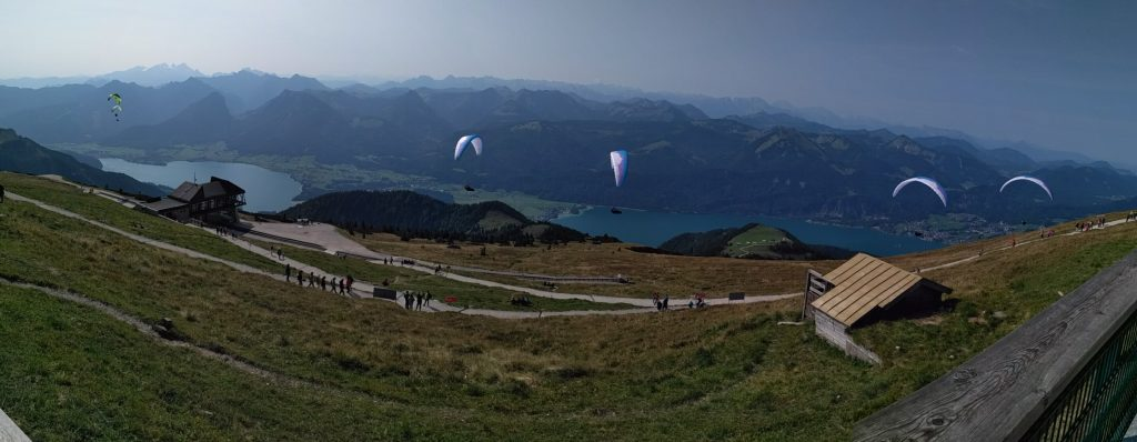 Panorama of para-gliders taking off atop the Schafberg